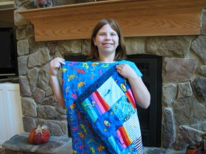 Faith showing off her first Quilt