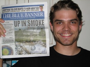 Kendall holds up his first published article.